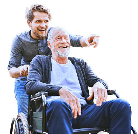elder man in a wheelchair with caregiver pointing at something