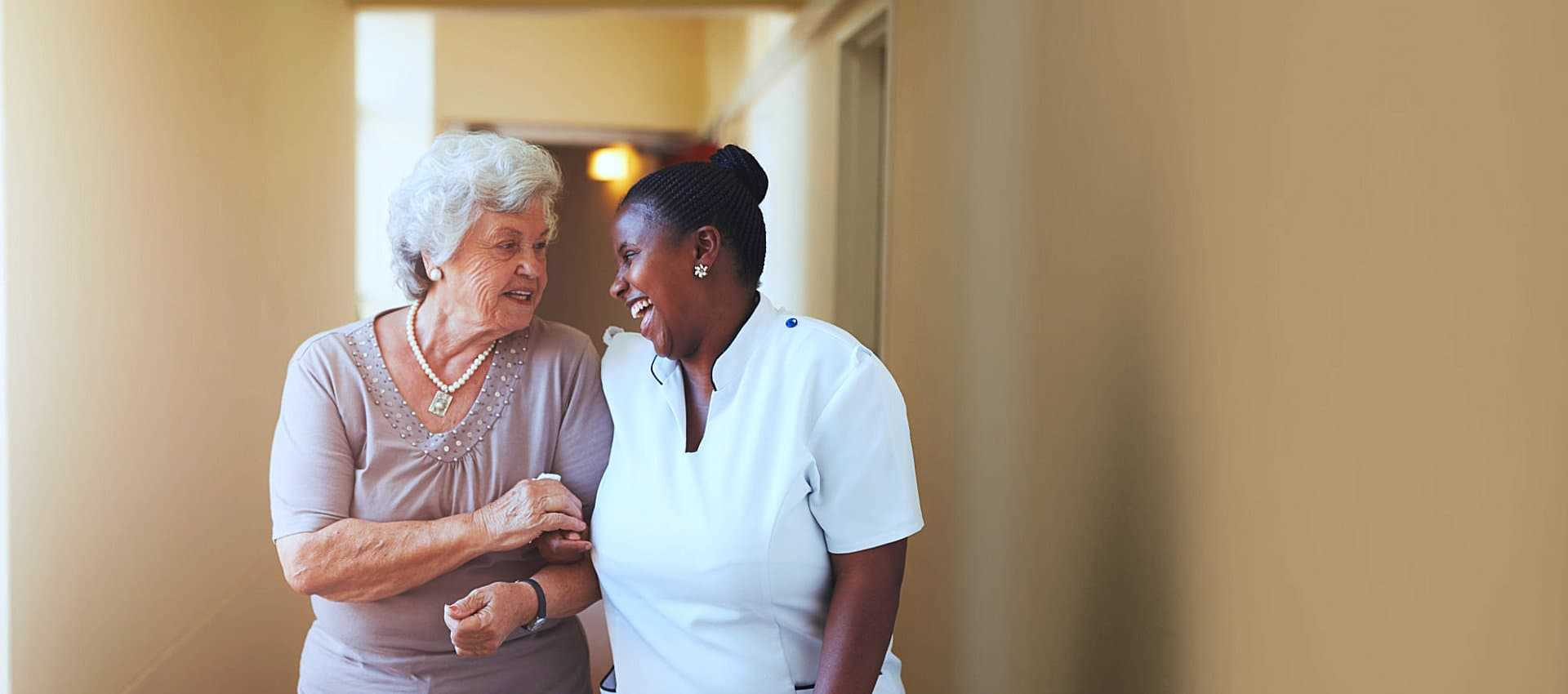 elder woman and caregiver talking
