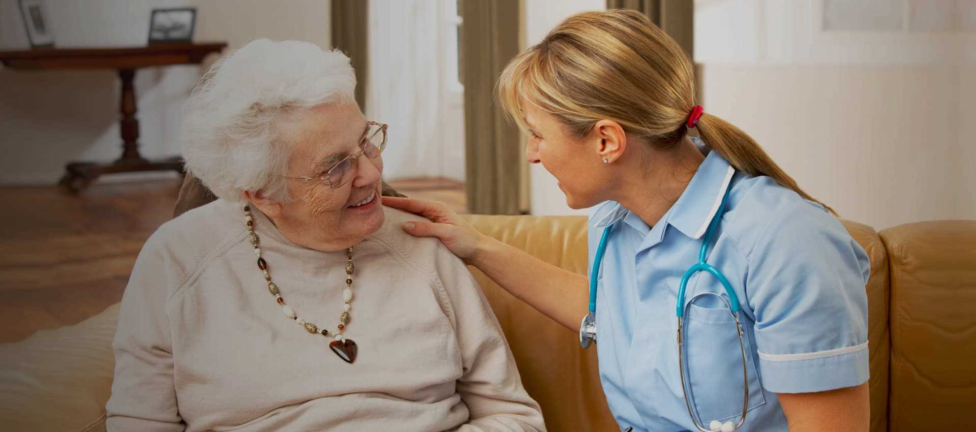 nurse talking to an elder woman